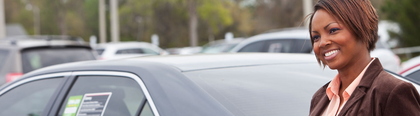Woman looking at new and used cars