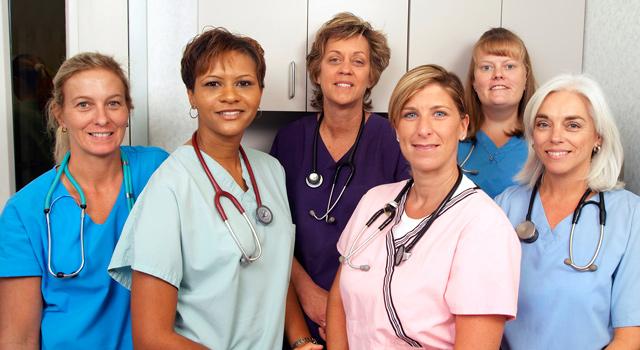 veterinarians and staff in new practice